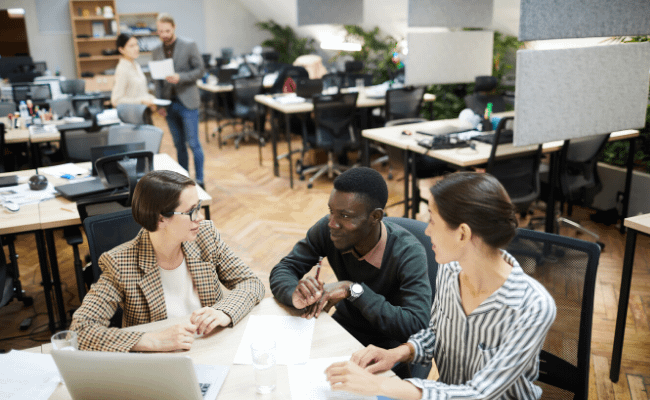 startup employees sitting in open space